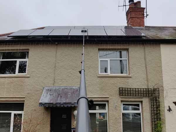Solar panels on a roof being cleaned by I B Cleaning.